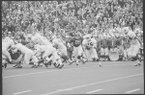 Texas quarterback James Street (16) runs with the ball during a game against Arkansas on Dec. 6, 1969, in Fayetteville. (Shiloh Museum of Ozark History /Northwest Arkansas Times Collection)