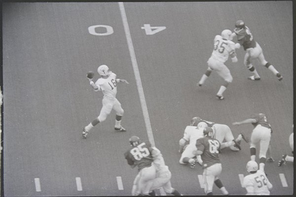 Texas quarterback James Street throws to Randy Peschel for 39 yards on fourth-and-3 in the fourth quarter of a game against Arkansas on Dec. 6, 1969. The play, called 53 Veer Pass, was arguably the most famous college football play of the 1960s and set up the No. 1 Longhorns' game-winning score in their game against the No. 2 Razorbacks. (Jerry Biazo, photographer, Shiloh Museum of Ozark History/Springdale News Collection)