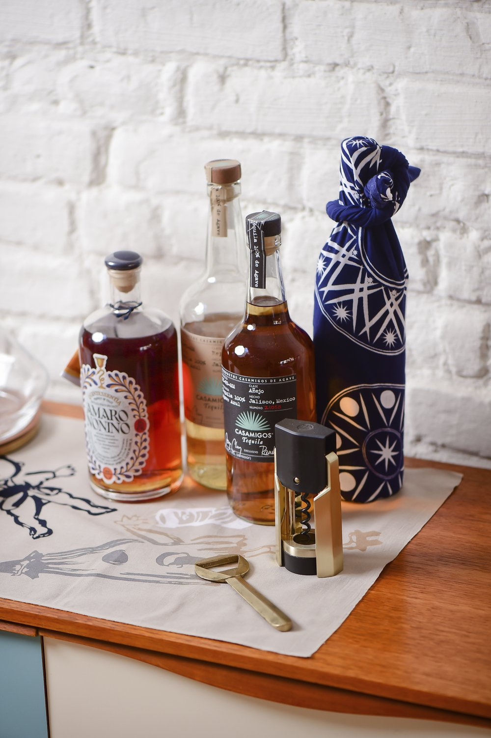 A traditional Tenugui cloth, similar to furoshiki, is used as an alternative to traditional gift wrapping for liquor bottle. Jazzy and sustainable, alternative gift wraps are gaining favor. (Max Flatow via AP/wuhao newyork Inc.)