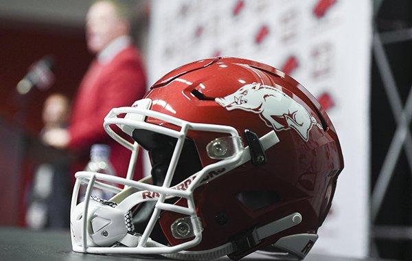 An Arkansas football helmet is shown as athletics director Hunter Yurachek during the introduction of new football coach Sam Pittman on Monday, Dec. 9, 2019, in Fayetteville.