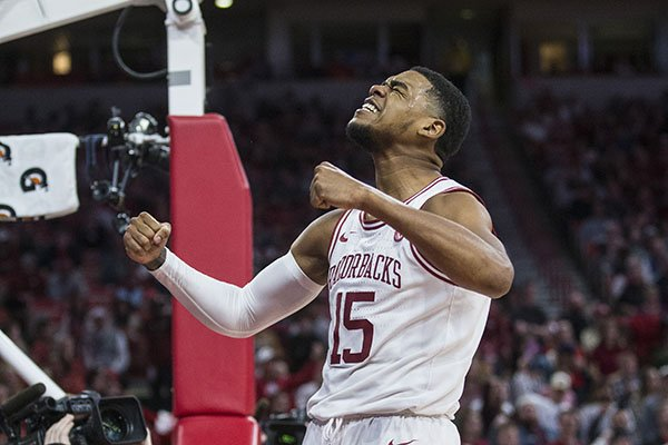 Arkansas guard Mason Jones celebrates after scoring a basket during a game against Tulsa on Saturday, Dec. 14, 2019, in Fayetteville.