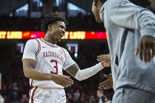 Arkansas guard Desi Sills is greeted by teammates during a game against Tulsa on Saturday, Dec. 14, 2019, in Fayetteville.