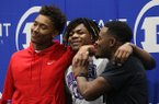 Bryant linebacker Catrell Wallace (left), safety Tamuarion Wilson (center) and linebacker Ahmad Adams (right) hug after a signing ceremony on Wednesday, Dec. 18, 2019, at Bryant High School. Wallace signed to play for Arkansas, Wilson signed with Central Arkansas and Adams signed with Arkansas State.