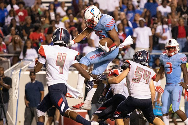 Little Rock Parkview tight end Erin Outley jumps over Marion defenders during a game Friday, Sept. 13, 2019, at War Memorial Stadium in Little Rock.