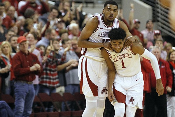 Arkansas' Mason Jones (15) celebrates with teammate Isaiah Joe (1) during a timeout after the Razorbacks took the lead late in the second half of Arkansas' 72-68 win over Valparaiso on Saturday, Dec. 21, 2019, at Simmons Bank Arena in North Little Rock.