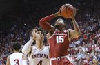 Arkansas guard Mason Jones (15) goes to the basket in front of Indiana forward Trayce Jackson-Davis (4) in the second half of an NCAA college basketball game in Bloomington, Ind., Sunday, Dec. 29, 2019. (AP Photo/AJ Mast)