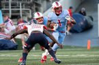 Little Rock Parkview running back James Jointer (1) tries to avoid a tackle by Marion linebacker Antonio Grays during a game Friday, Sept. 13, 2019, at War Memorial Stadium in Little Rock.