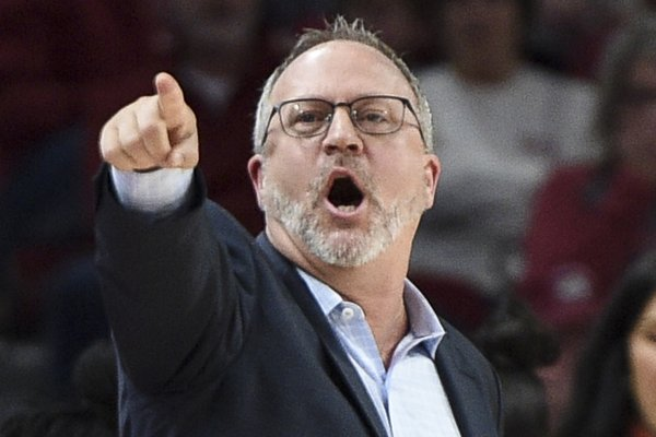 Arkansas women's basketball coach Mike Neighbors directs his team during the Razorbacks 84-77 loss to Texas A&M on Thursday, Jan. 2, 2020, in Fayetteville.