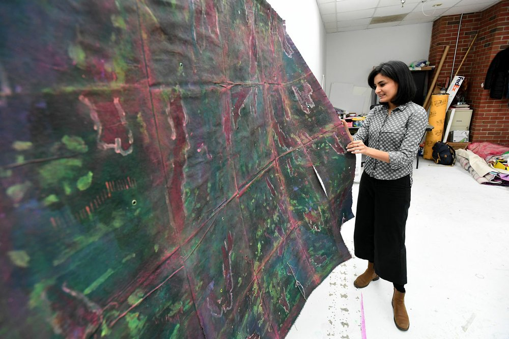"NWA Democrat-Gazette/J.T. WAMPLER Iranian artist Ziba Rajabi in her Fayetteville studio Dec. 5. ""All my works are about my living experiences,"" Rajabi said. ""It's something that I cannot ignore."" Rajabi's work involves layers of acrylic and watercolor on fabric and canvas, she said. Her pieces often flow down walls and onto the floor of the installation space."