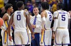 LSU head coach Will Wade, center, talks with his players, from left, Charles Manning Jr., Darius Days (0), Skylar Mays, partially obscured, Trendon Watford (2) and Emmitt Williams (5) during a timeout in the second half of an NCAA college basketball game, Saturday, Nov. 16, 2019, in Baton Rouge, La. LSU won 75-65. (AP Photo/Bill Feig)
