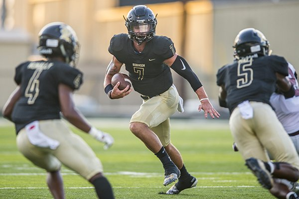 JT Towers of Joe T. Robinson runs with the ball during a game against Springdale on Friday, Aug. 30, 2019, at Charlie George Stadium in Little Rock.