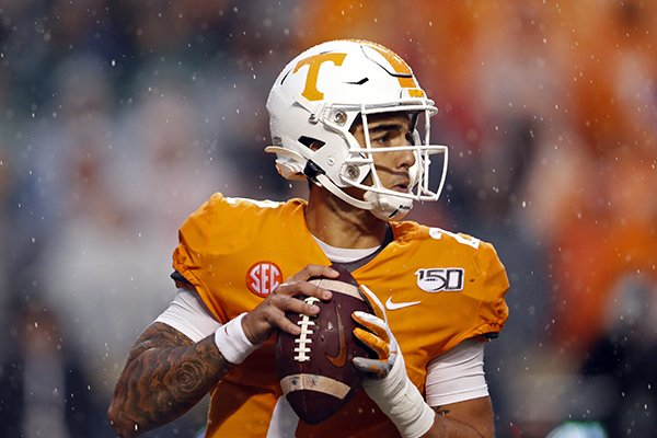 Tennessee quarterback Jarrett Guarantano (2) looks for a receiver in the first half of an NCAA college football game against Vanderbilt Saturday, Nov. 30, 2019, in Knoxville, Tenn. (AP Photo/Wade Payne)