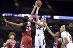 South Carolina guard Tyasha Harris (52) attempts to shoot against Arkansas forward Taylah Thomas (24) during the first half of an NCAA college basketball game Thursday, Jan. 9, 2020, in Columbia, S.C. (AP Photo/Sean Rayford)