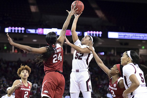 South Carolina guard Tyasha Harris (52) attempts to shoot against Arkansas forward Taylah Thomas (24) during the first half of an NCAA college basketball game Thursday, Jan. 9, 2020, in Columbia, S.C. (AP Photo/Sean Rayford)
