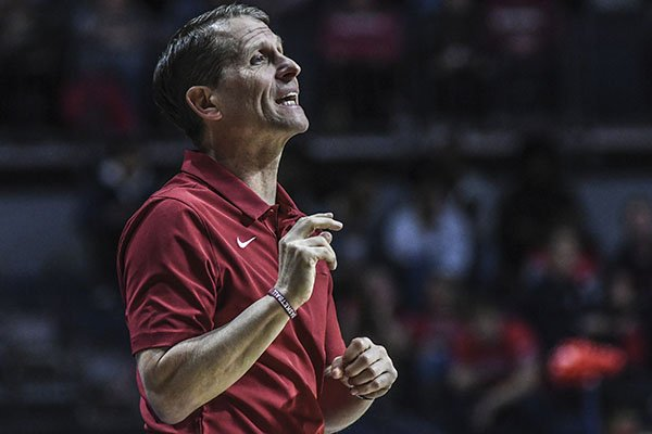 Arkansas coach Eric Musselman talks to the team during an NCAA college basketball game against Ole Miss in Oxford, Miss., Saturday, Jan. 11, 2020. (Bruce Newman/The Oxford Eagle via AP)