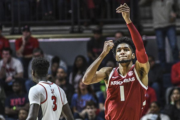 Arkansas guard Isaiah Joe (1) reacts after making a 3-pointer against Ole Miss during an NCAA college basketball game Saturday, Jan. 11, 2020, in Oxford, Miss. (Bruce Newman/The Oxford Eagle via AP)