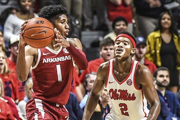 Arkansas guard Isaiah Joe (1) is defended by Ole Miss guard Devontae Shuler (2) during an NCAA college basketball game Saturday, Jan. 11, 2020, in Oxford, Miss. (Bruce Newman/The Oxford Eagle via AP)