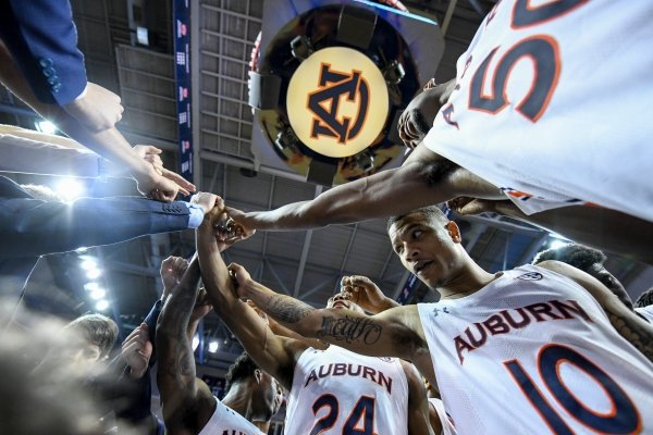 Auburn guard Samir Doughty (10) and the Tigers celebrate a win over Georgia in an NCAA college basketball game Saturday, Jan. 11 2020, in Auburn, Ala. (AP Photo/Julie Bennett)