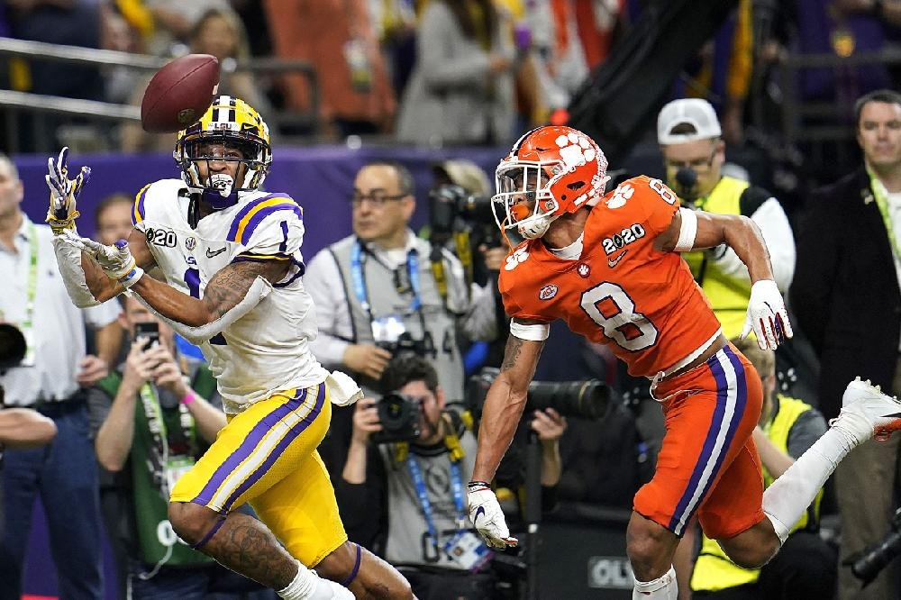 LSU wide receiver Ja'Marr Chase catches a touchdown pass in front of Clemson cornerback A.J. Terrell during the first half. Chase had 9 catches for 221 yards and 2 touchdowns.