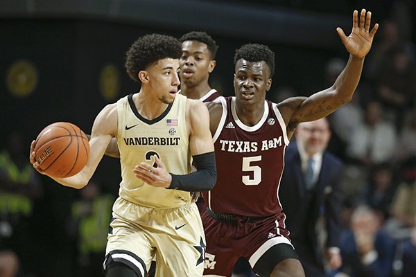 Vanderbilt guard Scotty Pippen Jr. (2) plays against Texas A&M forward Emanuel Miller (5) in the first half of an NCAA college basketball game Saturday, Jan. 11, 2020, in Nashville, Tenn. (AP Photo/Mark Humphrey)