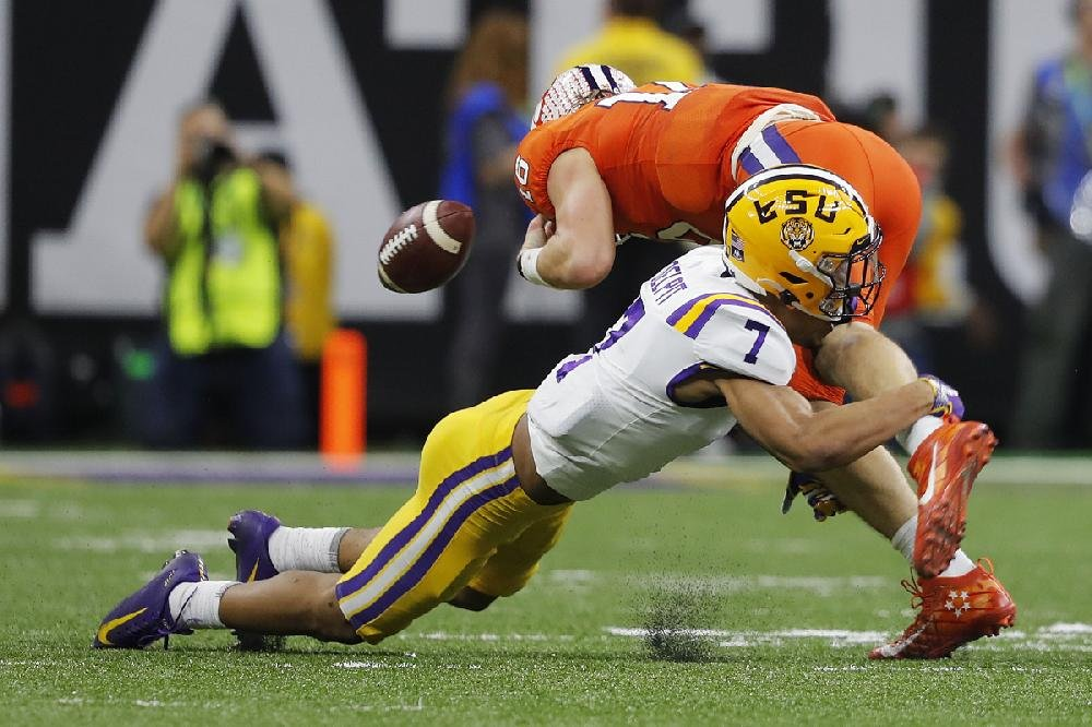 LSU safety Grant Delpit forces a fumble by Clemson quarterback Trevor Lawrence during the second half. Delpit had six tackles.