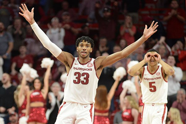 Arkansas guards Jimmy Whitt (33) and Jalen Harris (5) react to a made basket during a game against Vanderbilt on Wednesday, Jan. 15, 2020, in Fayetteville.