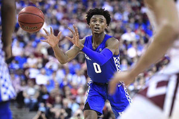 Kentucky guard Ashton Hagans (0) passes to a teammate during the first half of the team's NCAA college basketball game against South Carolina on Wednesday, Jan. 15, 2020, in Columbia, S.C. South Carolina won 81-78. (AP Photo/Sean Rayford)