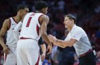 Eric Musselman, Arkansas head coach, confers with Isaiah Joe (1) and Jalen Harris in the second half vs Kentucky Saturday, Jan. 18, 2020, at Bud Walton Arena in Fayetteville. Go to nwaonline.com/photos to see more photos.