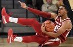 Arkansas guard Mason Jones (15) calls for a foul in the first half of an NCAA college basketball game against Georgia Tech Monday, Nov. 25, 2019, in Atlanta. (AP Photo/Danny Karnik)