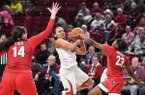 Arkansas' Chelsea Dungee (33) has a shot blocked by Georgia's Que Morrison (23) and Jenna Stati (14) during a game Thursday, Jan. 23, 2020, in Fayetteville.