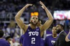 TCU guard Edric Dennis looks to fire the crowd during a time out in the second half of an NCAA college basketball game against Texas Tech in Fort Worth, Texas, Tuesday, Jan. 21, 2020. TCU won 65-54. (AP Photo/Ray Carlin)