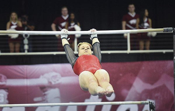 Arkansas' Sydney Laird performs on the bar during a gymnastics meet against Kentucky on Friday, Jan. 24, 2020, at Barnhill Arena in Fayetteville.