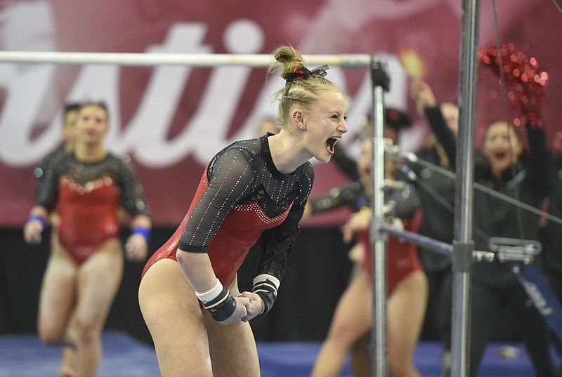 Bailey Lovett reacts after her bar routine, Friday, January 24, 2020 during a gymnastics meet at Barnhill Arena in Fayetteville. Check out nwaonline.com/photos/ for today's photo gallery. (NWA Democrat-Gazette/Charlie Kaijo) Arkansas Gymnastics hosted Kentucky.