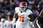 North defensive lineman McTelvin Agim of Arkansas (91) rushes the quarterback during the second half of the Senior Bowl college football game Saturday, Jan. 25, 2020, in Mobile, Ala. (AP Photo/Butch Dill)