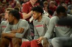 Arkansas guard Isaiah Joe (center) watches from the bench Saturday, Jan. 25, 2020, during the second half of the Razorbacks' 78-67 win over TCU in Bud Walton Arena. Joe was held out of the game because of an injury, according to university sports information officials.