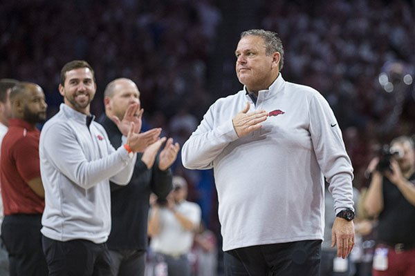Arkansas football coach Sam Pittman (right) is shown with his assistant coaching staff during the Razorbacks' basketball game against Kentucky on Saturday, Jan. 18, 2020, at Bud Walton Arena in Fayetteville. At left and facing is offensive coordinator Kendal Briles.