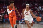 Arkansas guard Makayla Daniels (43) dribbles the ball against Florida guard Kiara Smith (1) during a game Sunday, Jan. 26, 2020, in Fayetteville.