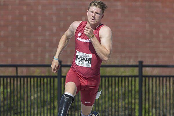 Arkansas' Hunter Woodhall runs during the third heat of the men's 400 meters Friday, April 27, 2018, during the National Relay Championships at John McDonnell Field in Fayetteville.