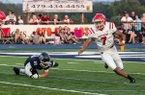 Special to NWA Democrat-Gazette/COREY S. KRASKO Fort Smith Northside quarterback Dreyden Norwood escapes Greenwood defender Jordan Hanna in the first quarter of Friday's game in Greenwood.