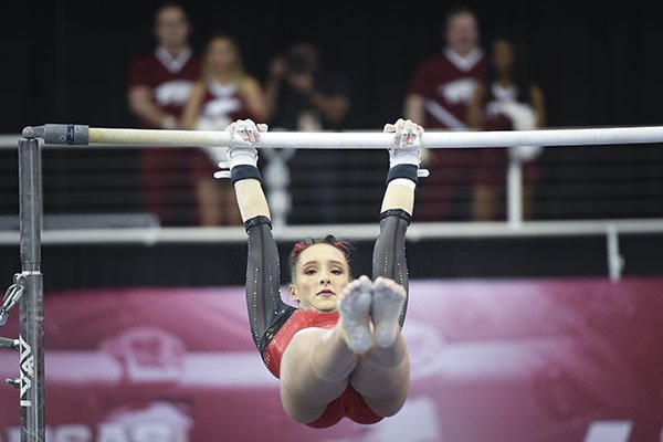 Arkansas' Kennedy Hambrick performs on the bar during a gymnastics meet against Kentucky on Friday, Jan. 24, 2020, at Barnhill Arena in Fayetteville.