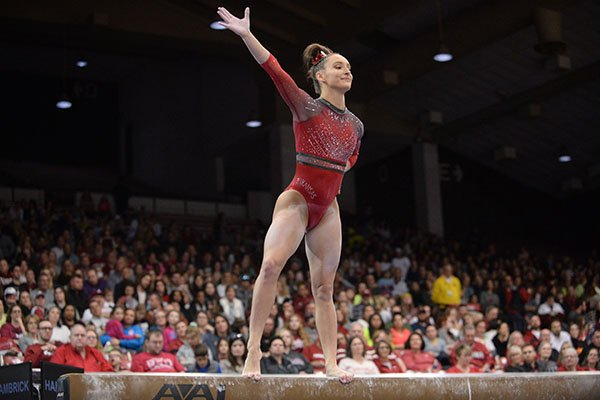 Arkansas' Kennedy Hambrick competes Friday, Feb. 7, 2020, in the beam portion of the Razorbacks' meet with Georgia in Barnhill Arena in Fayetteville.