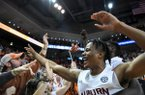 Auburn forward Isaac Okoro (23) celebrates with fans after their overtime win over LSU in an NCAA college basketball game Saturday, Feb. 8, 2020, in Auburn, Ala. (AP Photo/Julie Bennett)