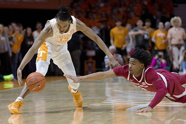 Tennessee guard Jalen Johnson (13) and Arkansas guard Desi Sills (3) go after a loose ball during an NCAA college basketball game, Tuesday, Feb. 11, 2020 in Knoxville, Tenn. (Brianna Paciorka/Knoxville News Sentinel via AP)
