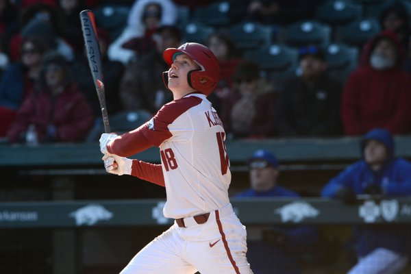 Arkansas right fielder Heston Kjerstad watches Friday, Feb. 14, 2020, as a home run sails over the left field wall during the seventh inning against Eastern Illinois at Baum-Walker Stadium in Fayetteville.
