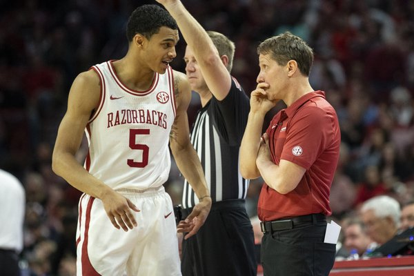 Arkansas Junior Jalen Harris (5) talking to coach Eric Musselman during at time out against Mississippi State,