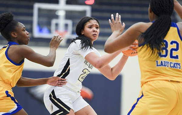 Nettleton guard Elauna Eaton (23) looks to pass during a game against North Little Rock on Thursday, Dec. 7, 2019, during the Great 8 girls basketball tournament at Rogers Heritage High School in Rogers.