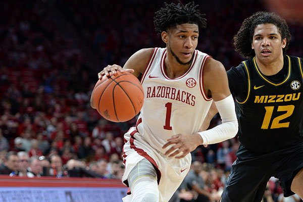 Arkansas guard Isaiah Joe (1) drives to the lane Friday, Feb. 21, 2020, as he is pressured by Missouri guard Dru Smith during the first half in Bud Walton Arena in Fayetteville.