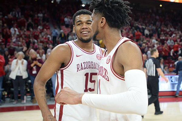 Arkansas guard Isaiah Joe (right) celebrates Saturday, Feb. 22, 2020, with Mason Jones after the Hogs' 78-68 win over Missouri in Bud Walton Arena in Fayetteville.