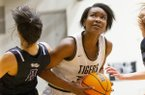 Fayetteville vs Bentonville Girls Varsity Basketball - Maryam Dauda (30) drives to the basket for two points against Fayetteville at Tiger Arena in Bentonville, Ark., on Friday, February 14, 2020.