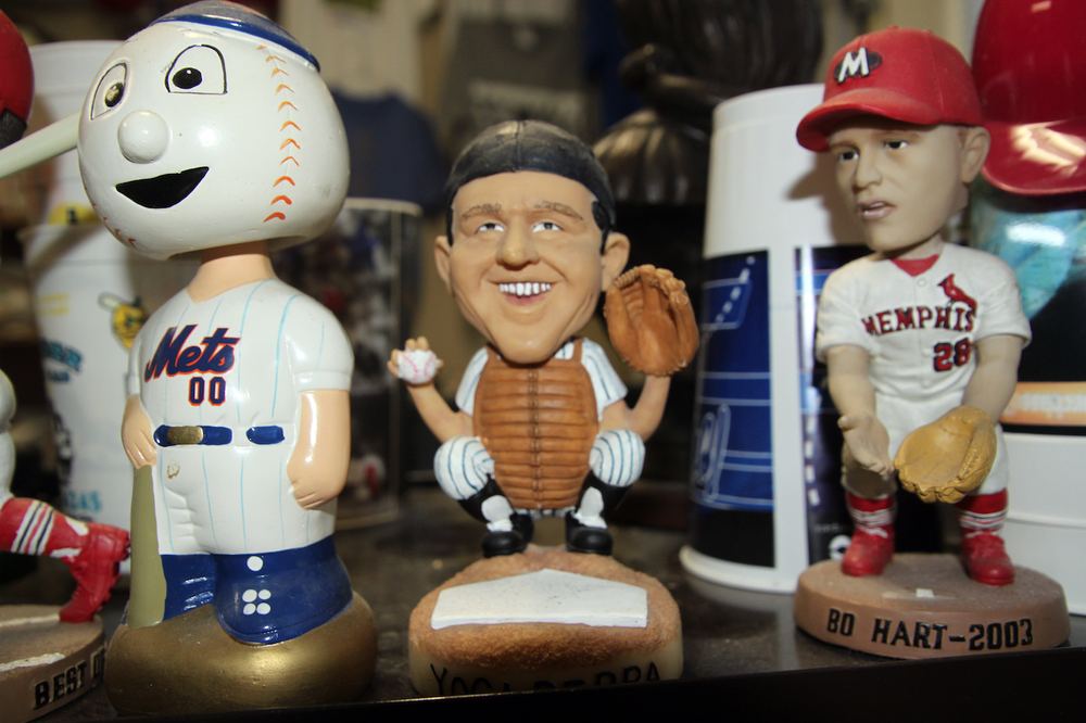 Bobbleheads are part of the collection of memorabilia of Fred Worth, professor of mathematics at Henderson State University in Arkadelphia. The bobblehead in the middle is the New York Yankees' legendary catcher Yogi Berra. Worth visited Berra's grave, which was his 5,000th gravesite to visit.